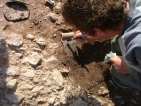 Excavating pot sherd at Mount Folly